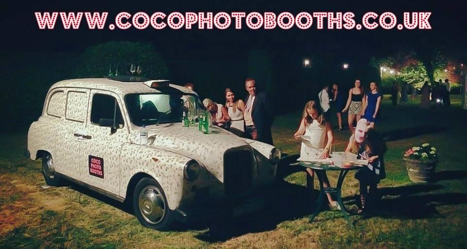 White taxi photo booth